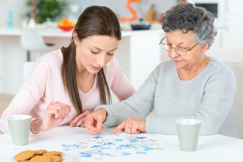 Senior Dementia Assistance - Playing Puzzles